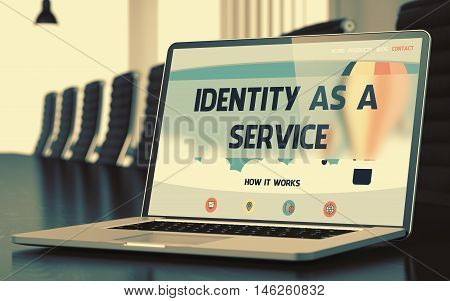 Identity As A Service on Landing Page of Mobile Computer Screen in Modern Meeting Room Closeup View. Toned. Blurred Image. 3D.