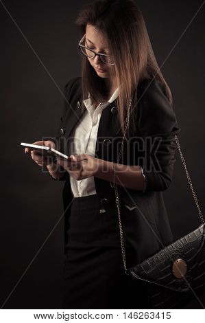 young teenage Korean girl with a tablet
