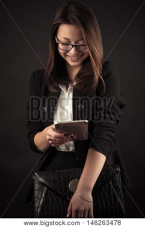attractive teenager girl working with tablet smiling