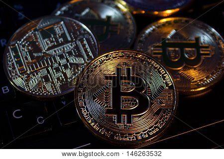Photo Golden Bitcoins new virtual money Close-up on a keybord.