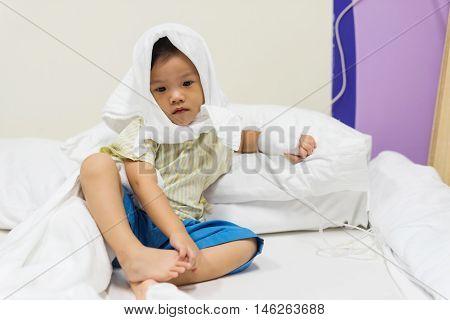 Muslim Boy With Headwear And Iv Solution