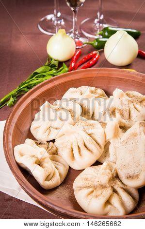 hot fresh georgian food.hinkali with parsley in restaurant