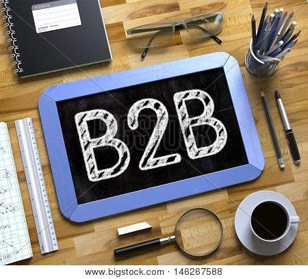 Blue Small Chalkboard with Handwritten Business Concept - B2B - on Office Desk and Other Office Supplies Around. Top View. B2B on Small Chalkboard. 3d Rendering.