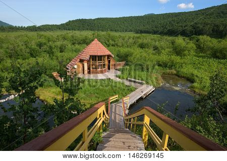 Small wooden hut near a bathing hotspring, Kamchatka, Russia