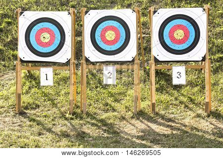 Three of paper archery targets in wooden stands