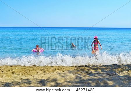 SIFNOS GREECE, AUGUST 27 2016: kids playing at the sea Sifnos island Cyclades Greece. Editorial use.