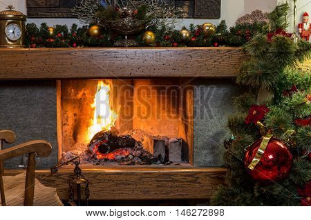 Cozy home ambience of burning fireplace and christmas decorations