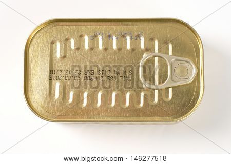 closed tin of sardines on white background