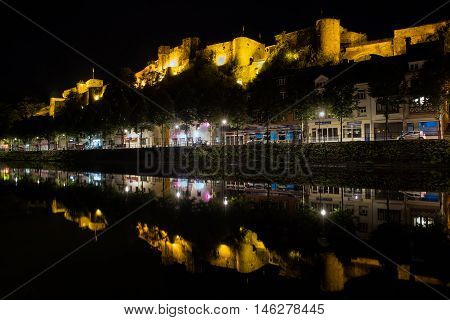 BOUILLON BELGIUM - AUG 22: Night view of Belgian medieval city with castle along river Semois in Ardennes on August 22 2016 in Bouillon Belgium