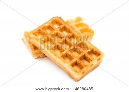 Freshly baked belgium waffles isolated on white background
