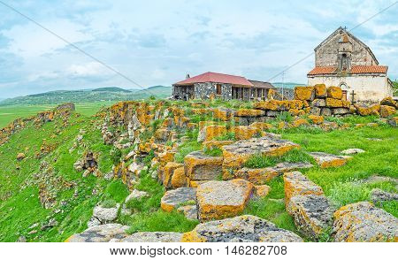 The medieval women Monastery on the mountain top surrounded by ruins of the megalithic fortresses Saro Georgia.