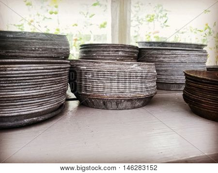 Retro style metal plates to be used with flower pots. Traditional craft.