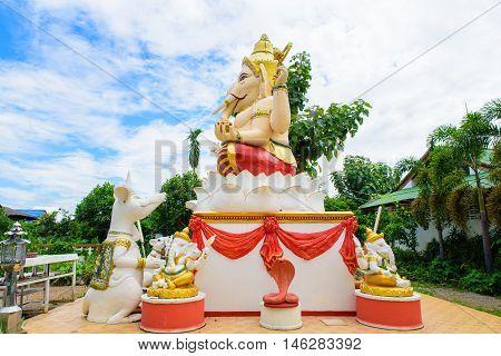 Ganesha Hindu God on the side with followers.