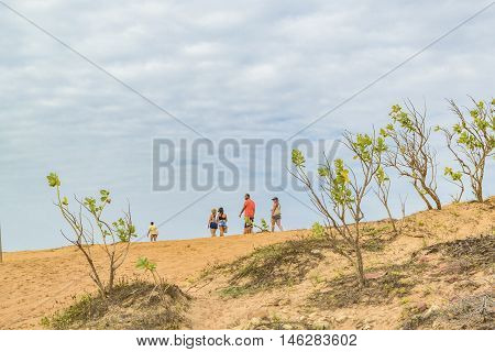 JERICOACOARA, BRAZIL, DECEMBER - 2015 - Low angle view of group of people walking at dunes in Jericoacoara Brazil