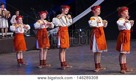 ROMANIA TIMISOARA - JULY 9 2016: Ukrainian child dancers in traditional costume present at the international folk festival