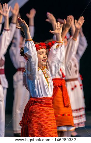ROMANIA TIMISOARA - JULY 9 2016: Ukrainian child dancers in traditional costume present at the international folk festival
