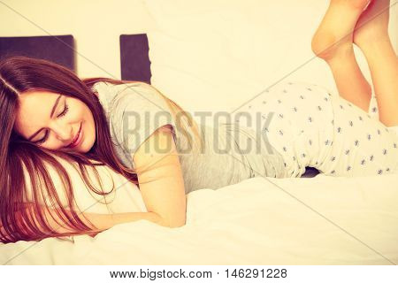 Beautiful Woman Lying On The Bed.