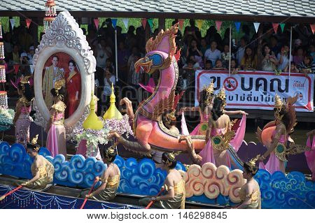 SAMUT PRAKAN , THAILAND - OCTOBER 26, 2015 : Beautiful flower boats in floating parade, the unique annual Rup Bua Festival ( Lotus Throwing Festival ) on end of Buddhist lent in Klong  Bangphli canal, Samut Prakan Province, Middle of Thailand.