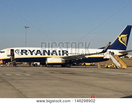 LISBON, PORTUGAL - AUG 25: Ryanair plane in Lisbon, Portugal, as seen on Aug 25, 2016. It is the largest European airline by passengers carried, and the busiest international airline by passengers.