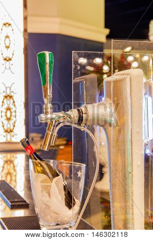 Close up beer dispenser valve in restaurant