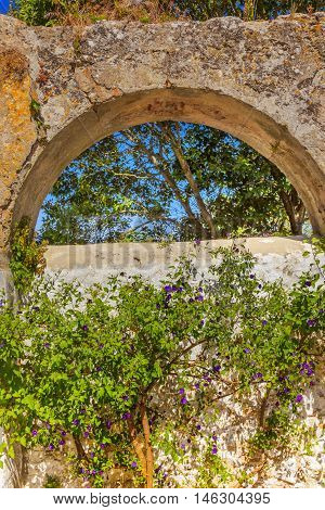Ancient Usseira Aqueduct Blue Flowers Obidos Portugal. Aqueduct created in 1575.
