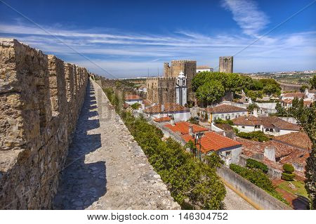 Sao Pedro Church Orange Roofs 11th Century Medieval Town Obidos Portugal. Church built in the late 13th/early 14th century. Castle and walls built in 11th century after town taken from the Moors.