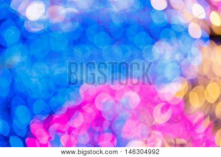 Gold Festive New Year Day background. Elegant abstract background with bokeh defocused lights and stars.