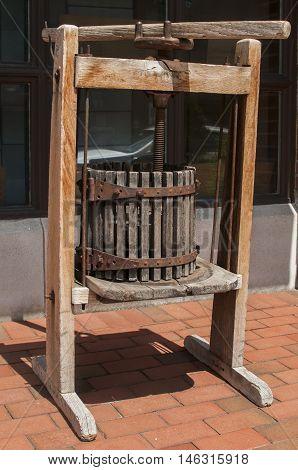 Old used vintage wooden basket press for winemaking