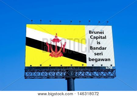 brunei flag on billboard with capital name - can use to education or montage on your product