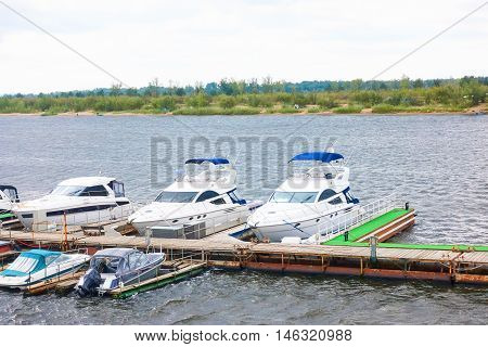Boats And Yachts On A Mooring In The Harbor. Cloudy Windy Weather.  The Islands Autumn.
