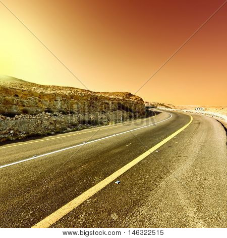 Asphalt Road in the Judean Desert on the West Bank at Sunset Vintage Style Toned Picture