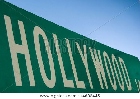 Hollywood street sign with blue sky behind