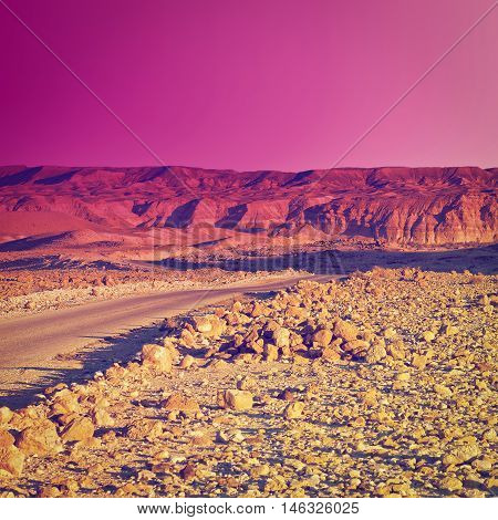 Meandering Road in Sand Hills of Judean Mountains Sunset Instagram Effect