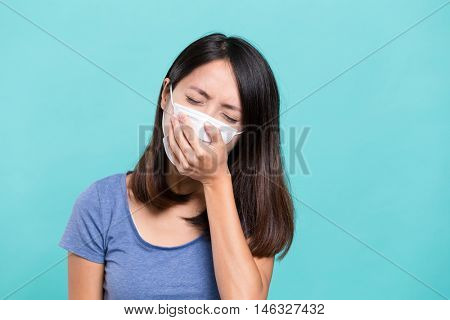 Woman wearing face mask and cough