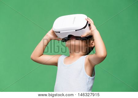 Little boy looking though virtual reality device