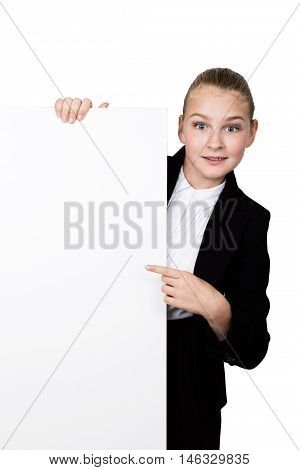 Little businesswoman standing behind and leaning on a white blank billboard or placard