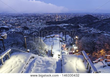 Sapporo Hokkaido JAPAN - December 12 2011: View of ski jump resort from the top of Mt. Okura in moments of twilight time in winter at Sapporo Hokkaido Japan