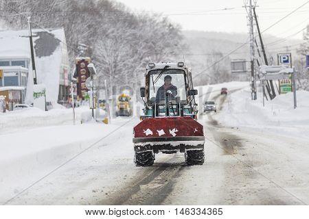 Hokkaido JAPAN - December 13 2011: Snow tractors running on road routes from Sapporo to Niseko in Hokkaido Japan