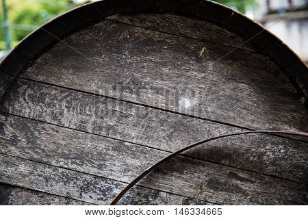 storage, winery, container and object concept - close up of old wooden barrel outdoors