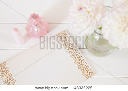Chrysanthemum In Vase, Perfume, Lipstick, Pen, Paper For Notes On White Background. Casual Creative
