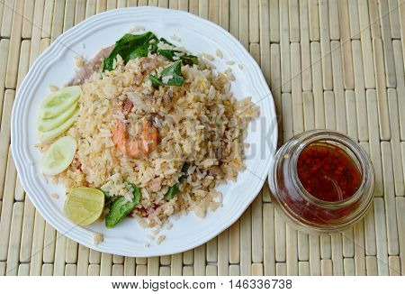 fried rice mixed seafood and pork and glass of fish sauce
