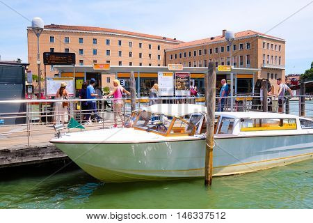 Venice, Italy, June, 21, 2016: the pier of public city voyage boats in Venice, Italy. This boats are the popular kind of public transport in Venice