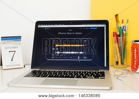 PARIS FRANCE - SEP 8 2016: Apple Computers website on MacBook Pro Retina in a geek creative room environment showcasing the new stere specs of iPhone 7