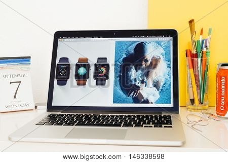 PARIS FRANCE - SEP 8 2016: Apple Computers website on MacBook Pro Retina in a geek creative room environment showcasing new Apple Watch Series 2 waterproof specs
