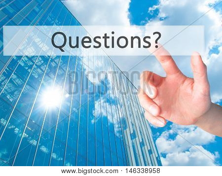 Questions ? - Hand Pressing A Button On Blurred Background Concept On Visual Screen.