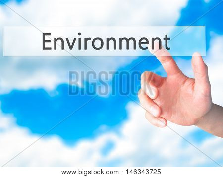 Environment - Hand Pressing A Button On Blurred Background Concept On Visual Screen.