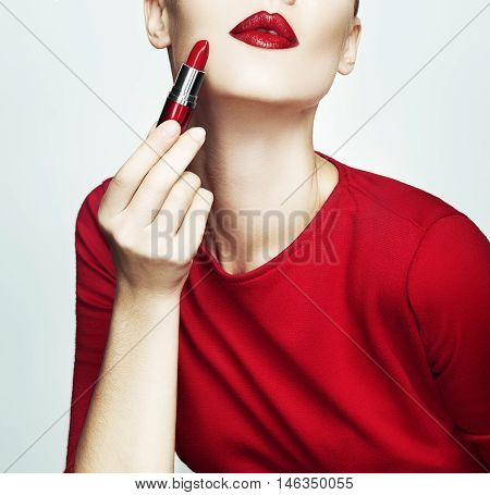 Fashion elegant lady in red dress with red lipstick and red lips.