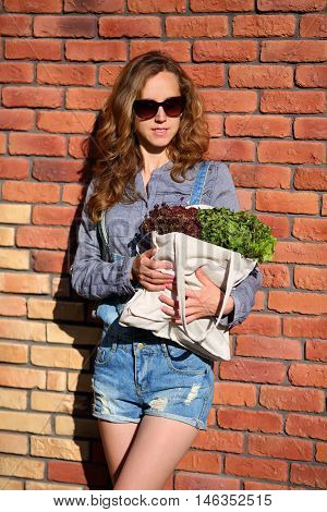 Woman Is Holding In Their Hands A Bag Full Of Lettuce