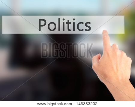 Politics - Hand Pressing A Button On Blurred Background Concept On Visual Screen.