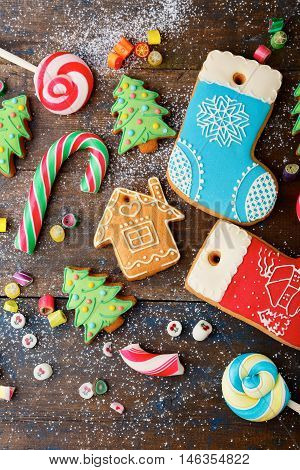 Different Christmas Gingerbread Cookies And Mixed Sweet Candy